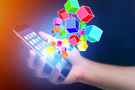 View of Colorfull data cube going out a smartphone - Technology concept
