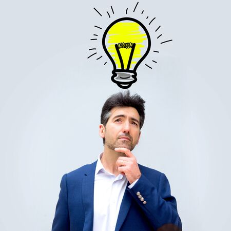 dubious: Portrait view of a businessman searching good idea with bulb lamp over his head - Imagination concept