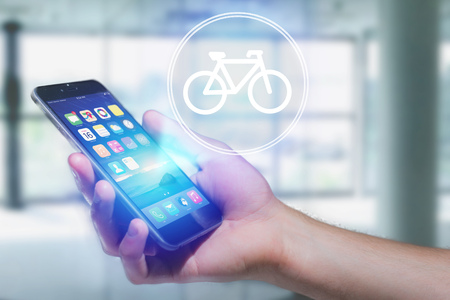 View of a Bicycle icon over device - Sport and technology concept Stock Photo