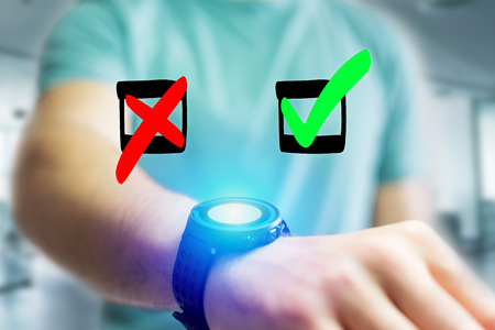 View of Hand drawn red and green tick icon going out a smartwatch interface of a man at the office - Business concept