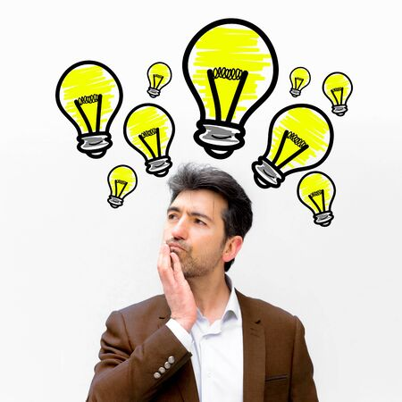 Portrait view of a businessman searching good idea with bulb lamp over his head - Imagination concept