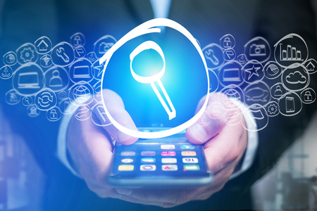 View of a Search icon going out a smartphone interface - technology concept