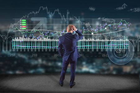 View of a Man in front of a wall writing on a stock exchange interface - tradex concept