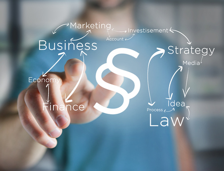 View of a Justice and law symbol displayed on a futuristic interface with business terms - technology and inspiration concept