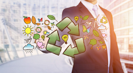 View of a Businessman touching ecology interface with arrow recycling logo Stock Photo