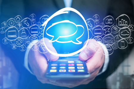 View of a Message icon going out a smartphone interface - technology concept