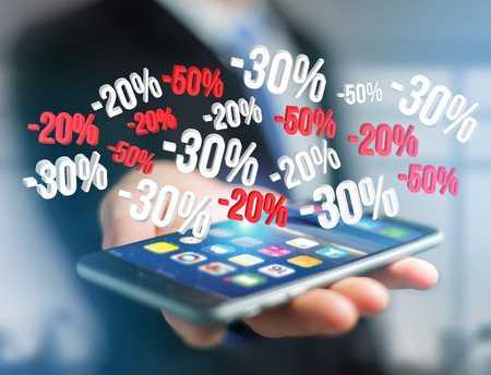 View of a Sales promotion 20% 30% and 50% flying over an interface - Shopping concept Stock Photo
