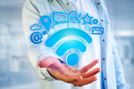View of a wifi symbol connection surrounded by multimedia and internet application logo - 3d rendering Banque d'images