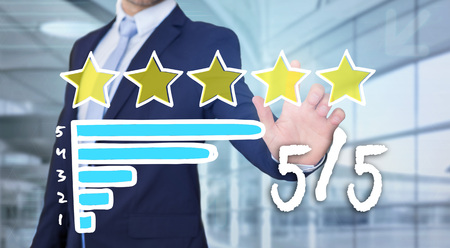 View of a Businessman touching technology interface with ranking stars  Stock Photo