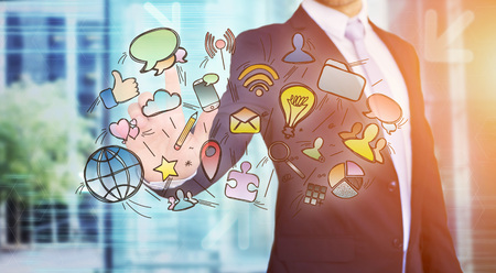 View of a Businessman touching multimedia icons on a technology interface - Creativity concept Stock Photo