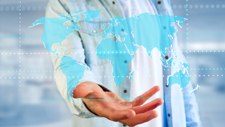 View of a Businessman holding a Connected world map on a futuristic interface - 3d render