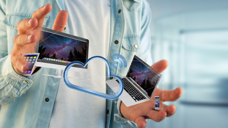 View of a Devices like smartphone, tablet or computer flying over connected cloud - 3d render Stock Photo