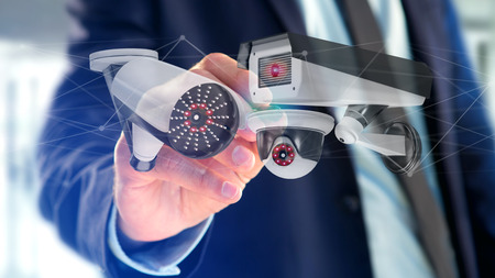 View of a Businessman holding a Security camera system and network connection - 3d rendering