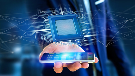 View of a Businessman using a smartphone with a Processor chip and network connection - 3d render Stock Photo - 97333639