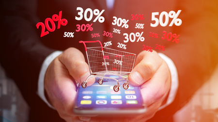 View of a Businessman using a smartphone with a Red and white Trolley and sales discount - 3d render Stock Photo