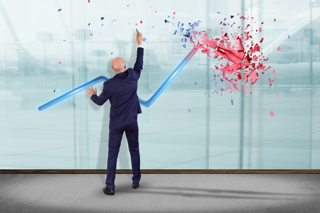 View of a Businessman in front of a wall with a Financial arrow going up and explosing at the end - 3d rendering 스톡 콘텐츠