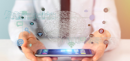 View of a Businessman holding a 3d rendering artificial intelligence concept with a brain and app Banque d'images