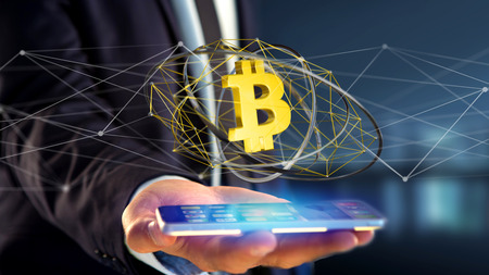 View of a Businessman using a smartphone with a Bitcoin crypto currency sign flying around a network connection - 3d render Stock Photo