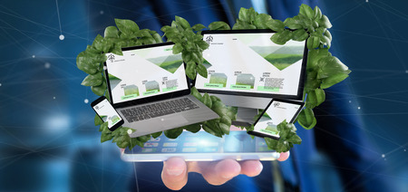 View of a businessman holding connected devices surrounding by leaves