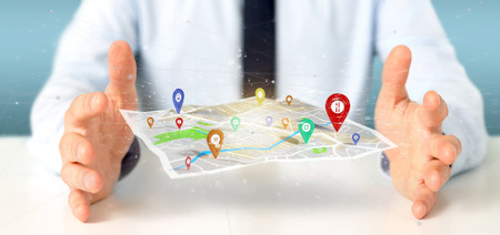 View of a Businessman holding a 3d rendering pin holder on a map