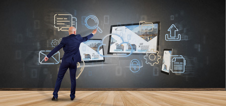 View of a Businessman in front of a Devices connected to a cloud multimedia network 3d rendering Stok Fotoğraf