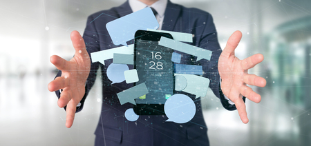 View of a Businessman holding a Messages bubbles surrounding a smartphone 3d rendering