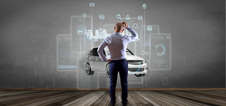 View of Businessman in front of a wall with Dashboard smartcar interface with multimedia icon and city map on a background 3d rendering