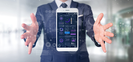 View of Businessman holding Smartphone with user interface data on the screen isolated on a background Stock Photo