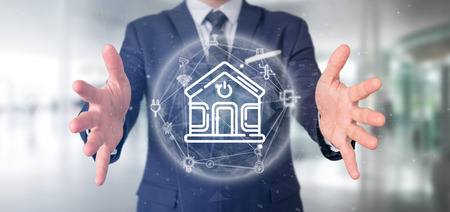 View of Businessman holding Smart home interface with icon, stats and data 3d rendering Stockfoto
