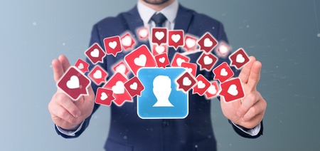 View of a Businessman holding  Like notification on a contact on a social media 3d rendering Stock Photo