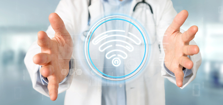 View of Doctor holding Wifi icon with stats and binary code 3d rendering Stock Photo