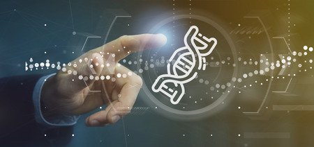 View of a Businessman holding  a DNA icon Stock Photo