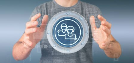 View of a Businessman holding a social media network contact icon