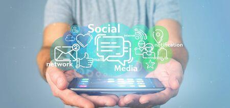 Ansicht eines Geschäftsmannes, der eine Wolke von Social-Media-Netzwerksymbolen hält