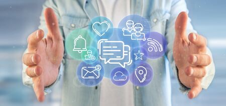 View of a Businessman holding a cloud of social media network icon