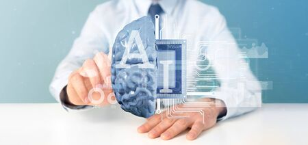 View of Business man holding artificial intelligence icon with half brain and half circuit 3d rendering