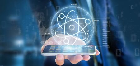 View of a Businessman holding an atom icon surrounded by data