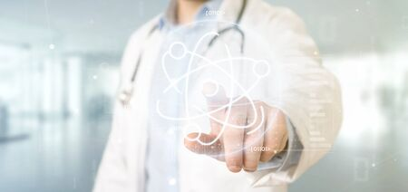 View of a Doctor holding an atom icon surrounded by data Zdjęcie Seryjne
