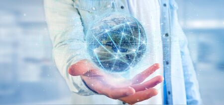 View of a Man holding Connection around a world globe isolated 3d rendering 스톡 콘텐츠