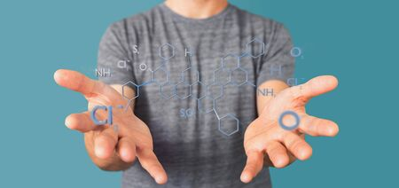View of a Businessman holding a 3d rendering molecule structure isolated on a background