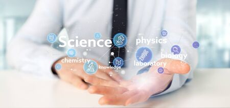 View of a Businessman holding Science icons and title