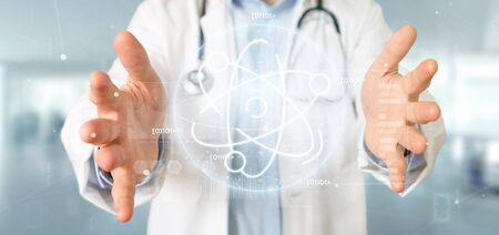 View of a Doctor holding an atom icon surrounded by data