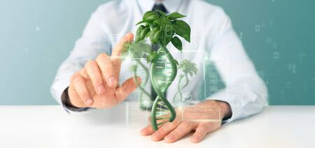View of a Businessman holding a DNA growing as a plant - 3d rendering