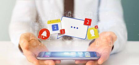 Vista de un empresario sosteniendo notificaciones de redes sociales - 3D rendering