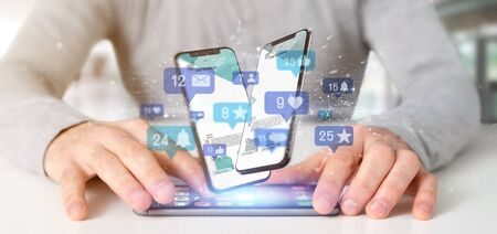 View of a Businessman holding Social network notifications - 3d rendering Foto de archivo