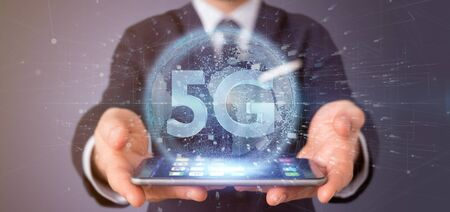 View of a Businessman holding a 5G connection with data surrounding - 3d rendering