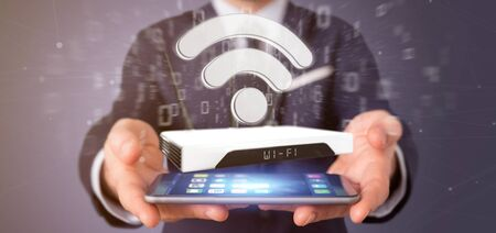 View of a Businessman holding a Wifi router and data - 3d rendering