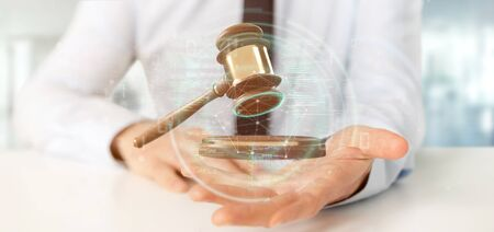View of a Businessman holding a Justice hammer and data - 3d rendering
