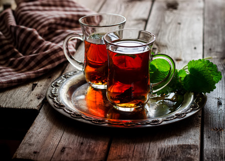 food on table: tea with mint in the Arab style on wooden table Stock Photo