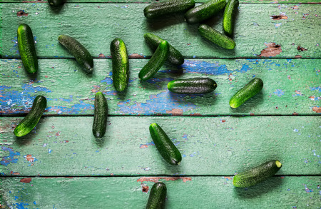 craked: Cucumbers on old green craked wooden table.
